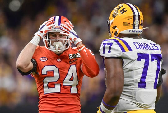 Clemson safety Nolan Turner (24) reacts after not intercepting a ball near LSU offensive Saahdiq Charles (77) during the fourth quarter of the National Championship game at the Mercedes Benz Superdome in New Orleans Monday, January 13, 2020.