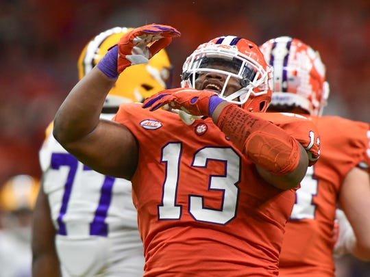 Clemson defensive lineman Tyler Davis (13) celebrates sacking LSU quarterback Joe Burrow (9) during the second quarter of the National Championship game at the Mercedes Benz Superdome in New Orleans Monday, January 13, 2020.