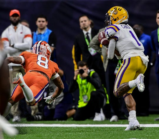 Clemson defensive back A.J. Terrell (8) watches LSU wide receiver Ja'Marr Chase (1) catch a pass near the end zone during the second quarter of the National Championship game at the Mercedes Benz Superdome in New Orleans Monday, January 13, 2020.