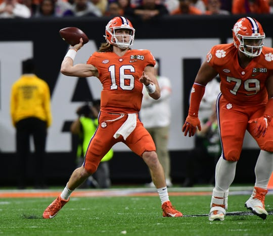 Clemson quarterback Trevor Lawrence (16) passes near offensive lineman Jackson Carman (79) during the second quarter of the National Championship game at the Mercedes Benz Superdome in New Orleans Monday, January 13, 2020.