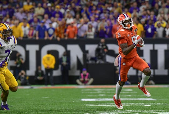 Clemson wide receiver Tee Higgins (5) runs by LSU defensive back Kary Vincent Jr. (5) for a 36-yard touchdown  during the second quarter of the National Championship game at the Mercedes Benz Superdome in New Orleans Monday, January 13, 2020.