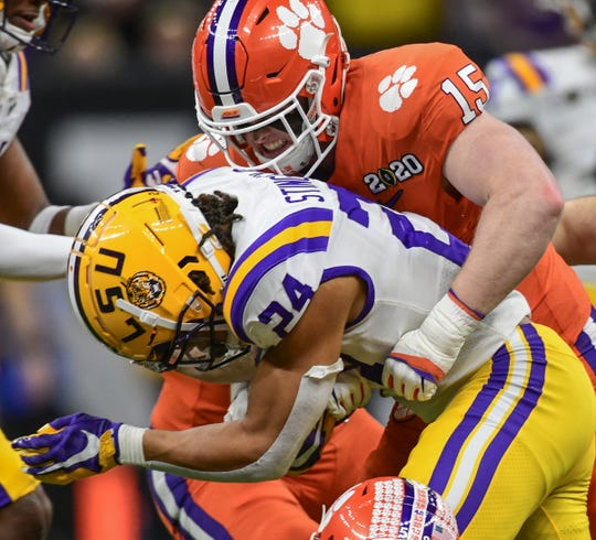 Clemson linebacker Jake Venables (15) tackles LSU running back Chris Curry (24) during the fourth quarter of the National Championship game at the Mercedes Benz Superdome in New Orleans Monday, January 13, 2020.
