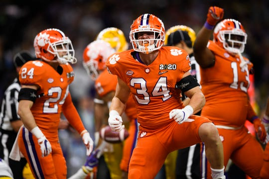 Clemson defensive end Logan Rudolph (34) celebrates during the College Football National Championship game against LSU at the Mercedes Benz Superdome Monday, Jan. 13, 2020.