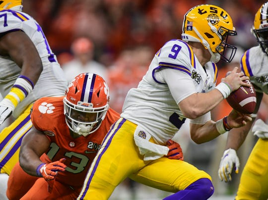 Clemson defensive lineman Tyler Davis (13) sacks LSU quarterback Joe Burrow (9) during the second quarter of the National Championship game at the Mercedes Benz Superdome in New Orleans Monday, January 13, 2020.