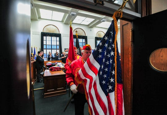 The Marine Corps League color guard presents the colors for the opening of the Great Falls Veterans Treatment Court graduation ceremony on Tuesday in the old federal courtroom in downtown Great Falls.