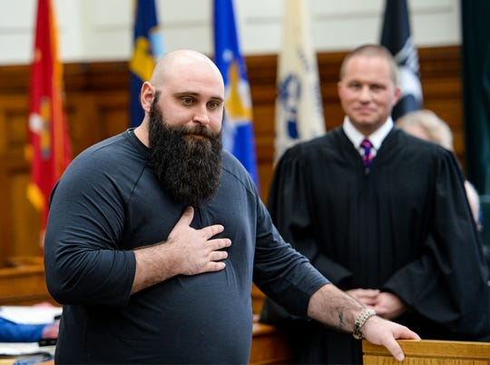 Great Falls Veterans Treatment Court graduate Kyle Ramon, a veteran of the Air Force, thanks the people who helped in his recovery during the Tuesday's graduation ceremony.