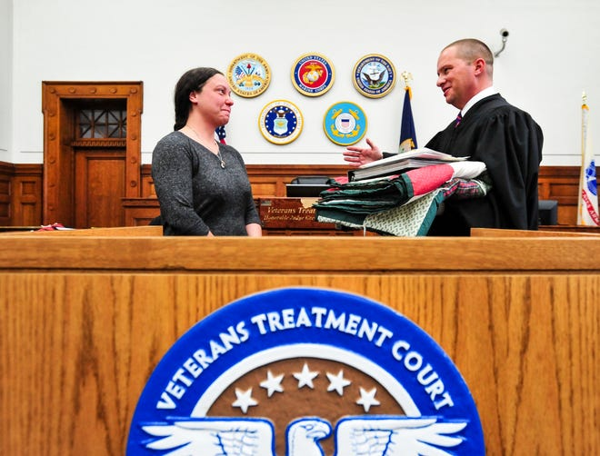 Army veteran Ashley Sattler is recognized by Judge Greg Pinski for her completion of the Great Falls Veterans Treatment Court during a graduation ceremony on Tuesday in the old federal courtroom in downtown Great Falls.