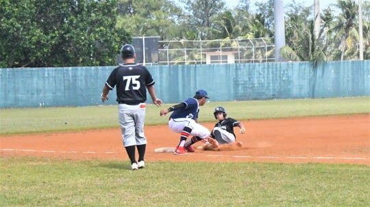 A New Zealand baserunner is caught at third base in the Guam vs. New Zealand U15 Oceania qualifier held Jan. 14 at the Paseo Stadium