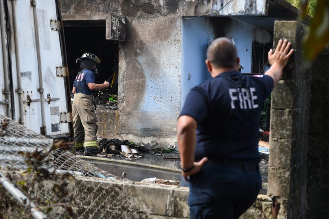 Guam firefighters work through the aftermath of a structure fire in Tamuning in this Jan. 14 file photo. The Guam Fire Department averaged $9.7 million a year of overtime from Oct. 1 2014 through Sept. 30, 2019, the Office of Public Accountability reported.
