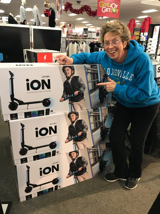 """Pam Garner of Henderson pauses in a store to make fun of her own scooter accident, which will be shown on """"America's Funniest Home Videos"""" this Sunday evening."""
