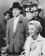 """Noble """"Kid"""" Chissell, (in checked suit) is a former Indianapolis boxer and one of 15-ex-fighters cast in """"Guys and Dolls"""" in 1955.  Vivian Blaine also stars."""