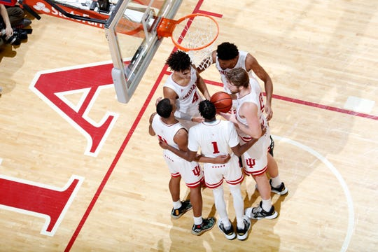 Indiana Hoosiers huddle up in a game against the Ohio State Buckeyes during the second half at Simon Skjodt Assembly Hall.