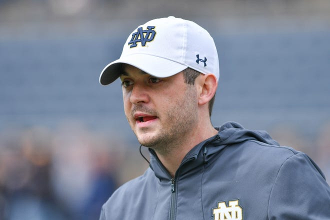 Notre Dame ended a month-long search for an offensive coordinator on Tuesday, naming quarterbacks coach Tommy Rees to the role.