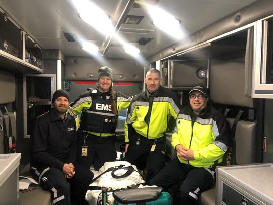 Paramedics Mike Mothershed, Alisia Meader, James Jurgensen and Cory Bonnett sit in the county's newest ambulance at the service headquarters Jan. 14, 2020, in Iowa City.
