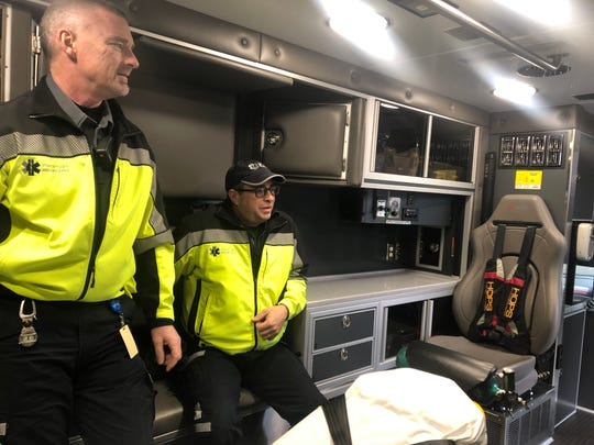 Paramedics James Jurgensen and Cory Bonnett describe safety features in the new Johnson County Ambulance truck Jan. 14, 2020, in Iowa City.