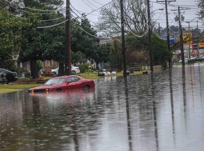 The National Weather Service says heavy rainfall that could lead to flash flooding is possible for the central Mississippi region on Wednesday. In this Jan 2020 file photo, a woman sits in her Dodge Charger submerged in water on Ellis Avenue during flash flooding in West Jackson.