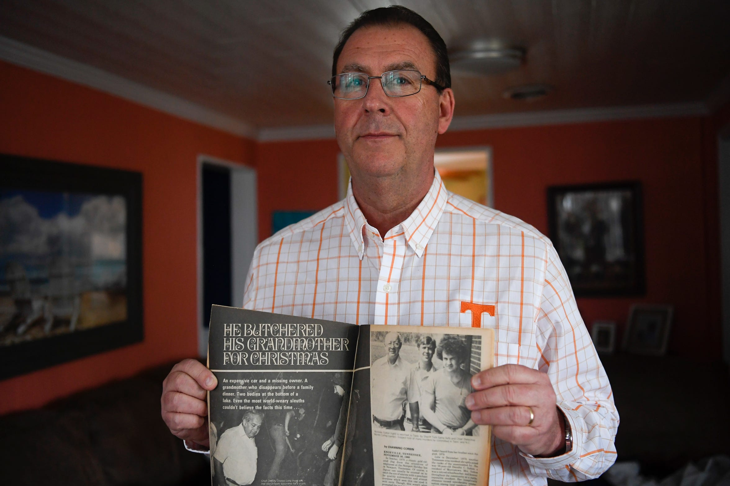 Martin Coffey, a former Hamblen County Sheriff's Office detective, stands in his New Market living room Saturday, Jan. 11, 2020. Coffey holds an old magazine with a story about Nicky Sutton's case, which was one of the first Coffey worked back in 1979.