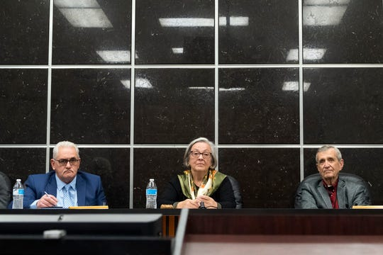 Tim Isbel, Catherine Denenberg and Bob Smallridge, members of the Anderson County Commission's intergovernmental committee, take comments from the public regarding the relationship of cancer and coal ash during a public meeting Monday, Jan.13, 2020, at the Anderson County Courthouse.