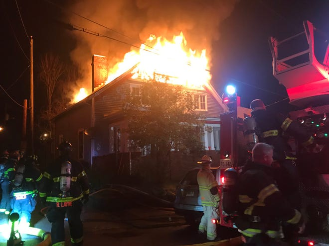Knoxville fire crews work to extinguish an apartment on the 1000 block of Thompson Place off Broadway on Tuesday, Jan. 14, 2019.
