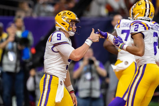 Quarterback Joe Burrow scores a touchdown as The LSU Tigers take on The Clemson Tigers in the 2020 College Football Playoff National Championship.  Monday, Jan. 13, 2020.