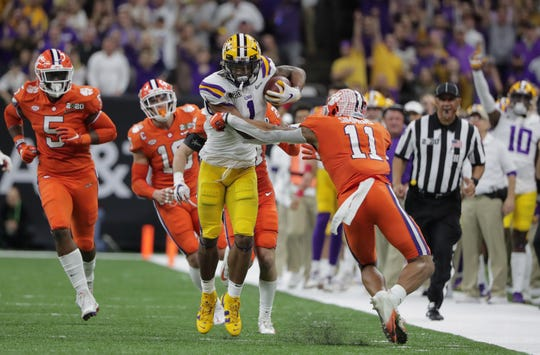 Jan 13, 2020; New Orleans, Louisiana, USA; LSU Tigers wide receiver Ja'Marr Chase (1) runs against Clemson Tigers linebacker Isaiah Simmons (11)  in the third quarter in the College Football Playoff national championship game at Mercedes-Benz Superdome. Mandatory Credit: Derick E. Hingle-USA TODAY Sports