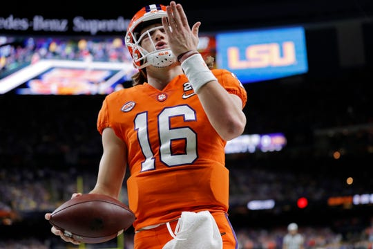 Clemson quarterback Trevor Lawrence celebrates after scoring during the first half of a NCAA College Football Playoff national championship game against LSU Monday, Jan. 13, 2020, in New Orleans. (AP Photo/Gerald Herbert)