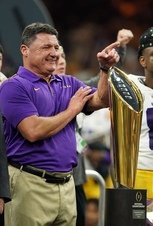 Jan 13, 2020; New Orleans, Louisiana, USA; LSU Tigers head coach Ed Orgeron celebrates on the podium after the LSU Tigers defeated the Clemson Tigers in the College Football Playoff national championship game at Mercedes-Benz Superdome. Mandatory Credit: John David Mercer-USA TODAY Sports