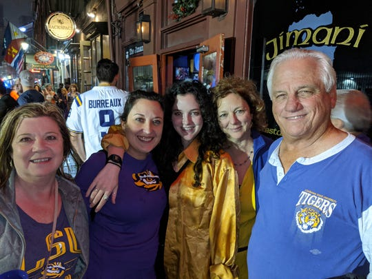 LSU alum Danny Ottenweller (far right) was in the stands Monday night for LSU's national championship victory. Here, he poses with family outside a French Quarter bar.