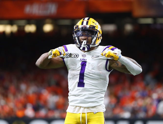 Jan 13, 2020; New Orleans, Louisiana, USA; LSU Tigers wide receiver Ja'Marr Chase (1) reacts against the Clemson Tigers in the third quarter in the College Football Playoff national championship game at Mercedes-Benz Superdome. Mandatory Credit: Mark J. Rebilas-USA TODAY Sports