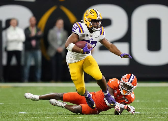 Jan 13, 2020; New Orleans, Louisiana, USA;  LSU Tigers running back Clyde Edwards-Helaire (22) runs past Clemson Tigers cornerback Derion Kendrick (1) in the fourth quarter in the College Football Playoff national championship game at Mercedes-Benz Superdome. Mandatory Credit: Kirby Lee-USA TODAY Sports