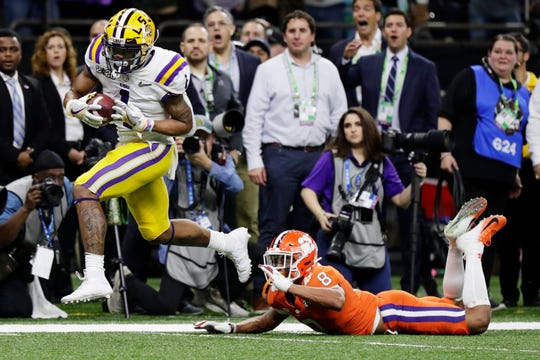LSU wide receiver Ja'Marr Chase scores past Clemson cornerback A.J. Terrell during the first half of a NCAA College Football Playoff national championship game Monday, Jan. 13, 2020, in New Orleans. (AP Photo/Sue Ogrocki)