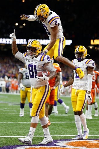 LSU tight end Thaddeus Moss celebrates after scoring during the first half of a NCAA College Football Playoff national championship game against Clemson, Monday, Jan. 13, 2020, in New Orleans. (AP Photo/Gerald Herbert)