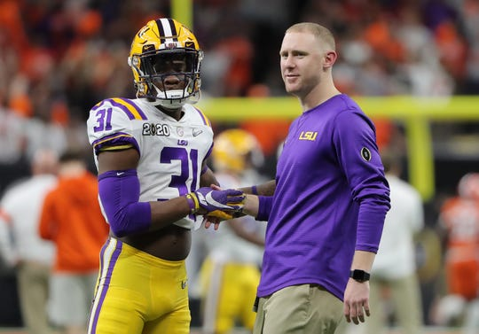 Jan 13, 2020; New Orleans, Louisiana, USA; LSU Tigers safety Cameron Lewis (31) talks with passing game coordinator Joe Brady before the College Football Playoff national championship game against the Clemson Tigers at Mercedes-Benz Superdome. Mandatory Credit: Derick E. Hingle-USA TODAY Sports