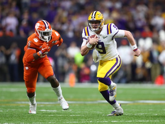 Jan 13, 2020; New Orleans, Louisiana, USA; LSU Tigers quarterback Joe Burrow (9) runs past Clemson Tigers defensive end K.J. Henry (5) first half in the College Football Playoff national championship game at Mercedes-Benz Superdome. Mandatory Credit: Mark J. Rebilas-USA TODAY Sports
