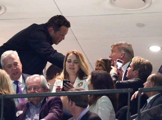 Jan 13, 2020; New Orleans, Louisiana, USA; Movie actor Vince Vaughn greets First Lady Melania Trump and President Donald J. Trump in the College Football Playoff national championship game between the Clemson Tigers and the LSU Tigers at Mercedes-Benz Superdome. Mandatory Credit: Mark J. Rebilas-USA TODAY Sports