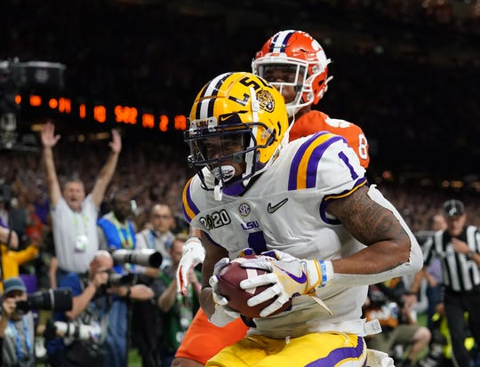 Jan 13, 2020; New Orleans, Louisiana, USA; LSU Tigers wide receiver Ja'Marr Chase (1) catches a touchdown pass against Clemson Tigers cornerback A.J. Terrell (8) second quarter in the College Football Playoff national championship game at Mercedes-Benz Superdome. Mandatory Credit: Kirby Lee-USA TODAY Sports