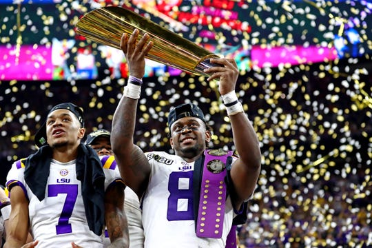 Jan 13, 2020; New Orleans, Louisiana, USA; LSU Tigers linebacker Patrick Queen (8) celebrates with the National Championship trophy after beating the Clemson Tigers in the College Football Playoff national championship game at Mercedes-Benz Superdome. Mandatory Credit: Matthew Emmons-USA TODAY Sports