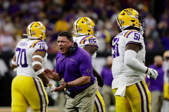 LSU head coach Ed Orgeron cheers during the first half of a NCAA College Football Playoff national championship game against Clemson Monday, Jan. 13, 2020, in New Orleans. (AP Photo/Sue Ogrocki)