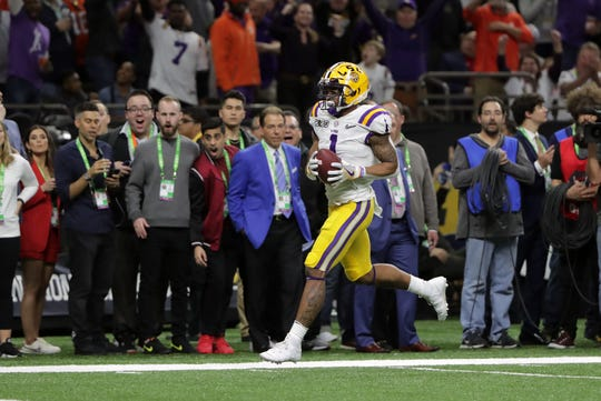 Jan 13, 2020; New Orleans, Louisiana, USA; LSU Tigers wide receiver Ja'Marr Chase (1) runs to score a touchdown against the Clemson Tigers in the first quarter in the College Football Playoff national championship game at Mercedes-Benz Superdome. Mandatory Credit: Derick E. Hingle-USA TODAY Sports