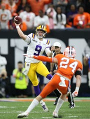 Jan 13, 2020; New Orleans, Louisiana, USA; LSU Tigers quarterback Joe Burrow (9) throws a pass against the Clemson Tigers first half in the College Football Playoff national championship game at Mercedes-Benz Superdome. Mandatory Credit: Chuck Cook-USA TODAY Sports