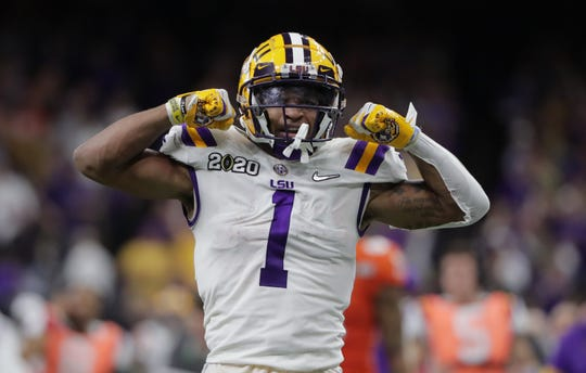 Jan 13, 2020; New Orleans, Louisiana, USA; LSU Tigers wide receiver Ja'Marr Chase (1) celebrates after making a 43 yard run against the Clemson Tigers in the third quarter in the College Football Playoff national championship game at Mercedes-Benz Superdome. Mandatory Credit: Derick E. Hingle-USA TODAY Sports