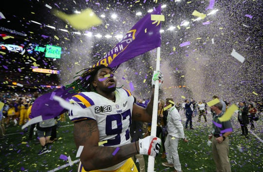 Jan 13, 2020; New Orleans, Louisiana, USA; LSU Tigers defensive end Glen Logan (97) celebrates after the LSU Tigers defeated the Clemson Tigers in the College Football Playoff national championship game at Mercedes-Benz Superdome. Mandatory Credit: Derick E. Hingle-USA TODAY Sports