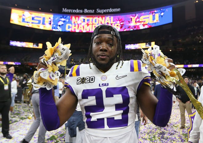 Jan 13, 2020; New Orleans, Louisiana, USA; LSU Tigers linebacker Micah Baskerville (23) celebrates after the LSU Tigers defeated the Clemson Tigers in the College Football Playoff national championship game at Mercedes-Benz Superdome. Mandatory Credit: Derick E. Hingle-USA TODAY Sports