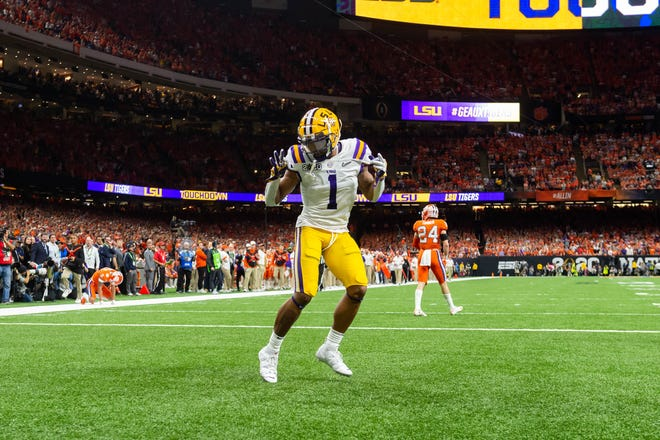 Ja'Marr Chase scores a touchdown as The LSU Tigers take on The Clemson Tigers in the 2020 College Football Playoff National Championship.  Monday, Jan. 13, 2020.