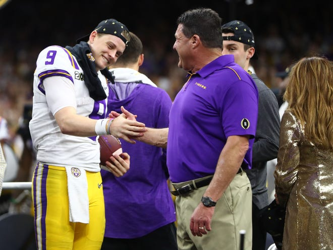 Jan 13, 2020; New Orleans, Louisiana, USA; LSU Tigers head coach Ed Orgeron celebrates with quarterback Joe Burrow (9) after defeating the Clemson Tigers in the College Football Playoff national championship game at Mercedes-Benz Superdome. Mandatory Credit: Mark J. Rebilas-USA TODAY Sports