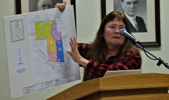 """Glenda """"Nellie"""" Dyball gestures to a zoning map of property a waiting a decision from Lancaster City Council  on annexation during a public hearing Monday, Jan. 13. Several city residents, including Dyball, spoke out against the annexation, citing traffic, water flow and aesthetic issues."""