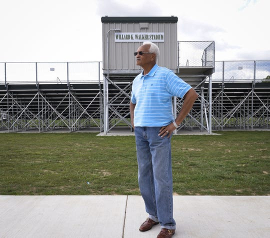 Willard Walker, the first chair of the Dr. Martin Luther King Jr. Commission of Mid-Michigan, is shown in 2017 at the new stadium at Risdale Park in Lansing that was named in his honor. Walker says the commission's work has always focused on community involvement, not just  the annual holiday luncheon it organizes.