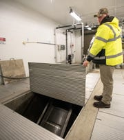 Jeff Rewerts, a utility foreman for the City of Mason shows part of the initial  filtration process where solids are removed from incoming sewerage Tuesday, Jan. 14, 2020, at the headworks building, part of the Mason wastewater treatment plant, which went online in 2017.
