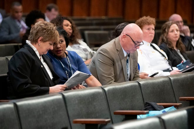 Chief Financial Officer Shirley Ford (from left) talks with Chief Communications Officer Ursula Madden while Chief Operating Officer Doug McGowen looks at his phone Tuesday, Jan. 7, 2020, during a Memphis City Council meeting at City Hall. Also pictured are Memphis Fire Services Director Gina Sweat and Chief Legal Officer Jennifer Sink.