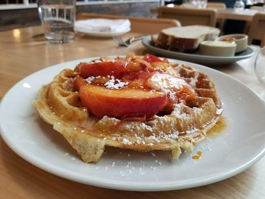If you're visiting Seattle, make sure to try Sourdough Waffles With Fruit from the chef's farm.